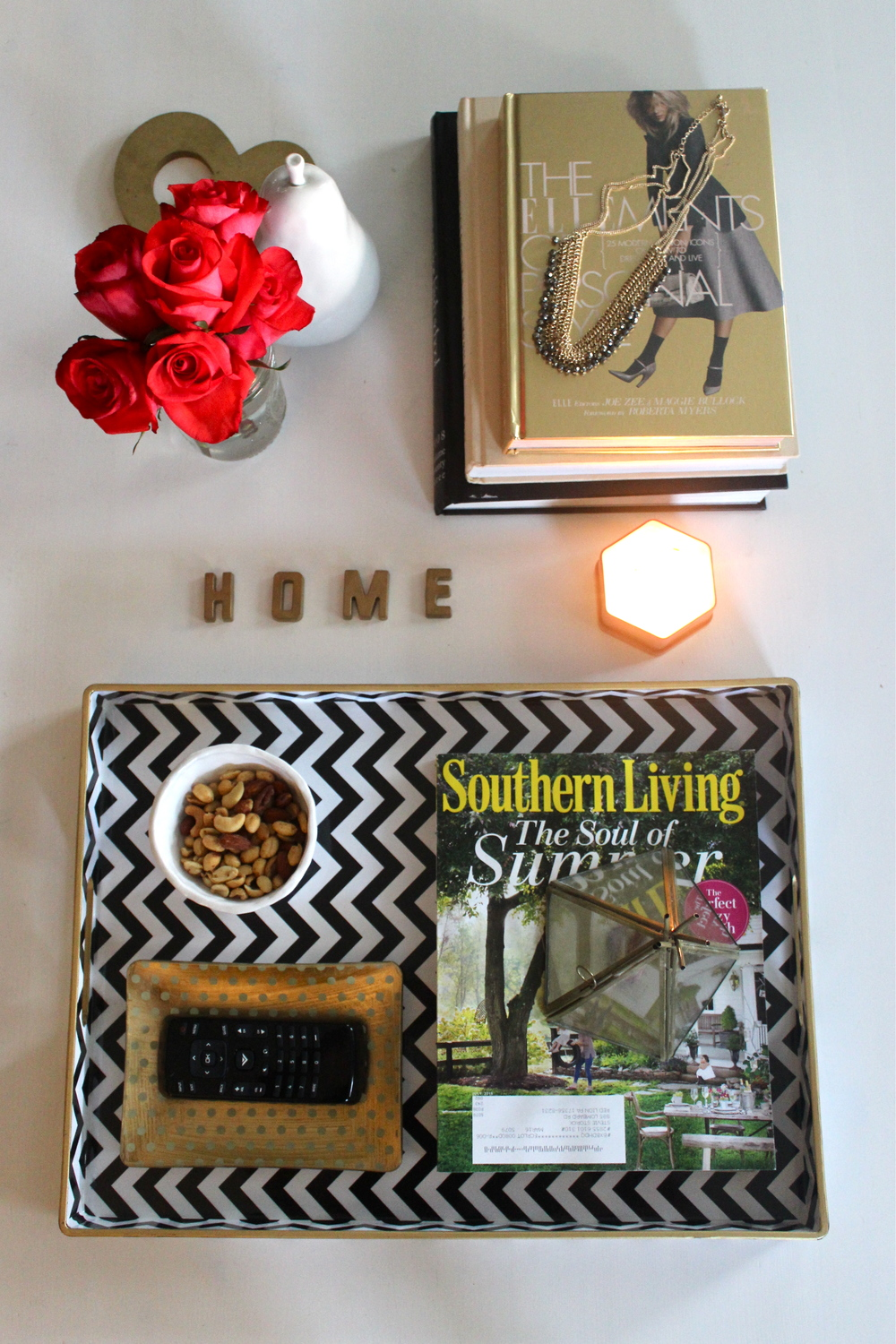 How to Style a Coffee Table - Stevie Storck Design Co.  {Black, white, gold and hot pink}