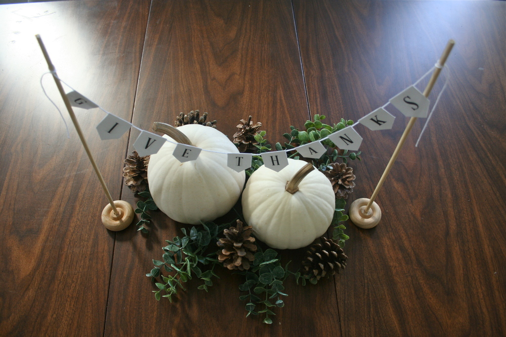 "Pumpkin, pinecone and eucalyptus Fall centerpiece. Printable ""Give Thanks"" Banner. Perfect last minute addition to your Thanksgiving decor! Free Download from Stevie Storck Design Co."