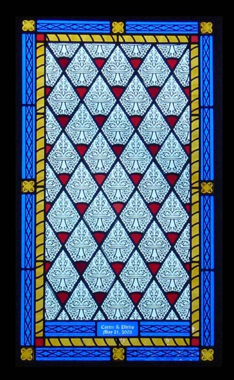 This window is created mostly by silk screening. It was inspired by the church where the couple was married. By taking pictures of the windows, I could recreate the same look and feeling of that memorable moment in a personal gift.
