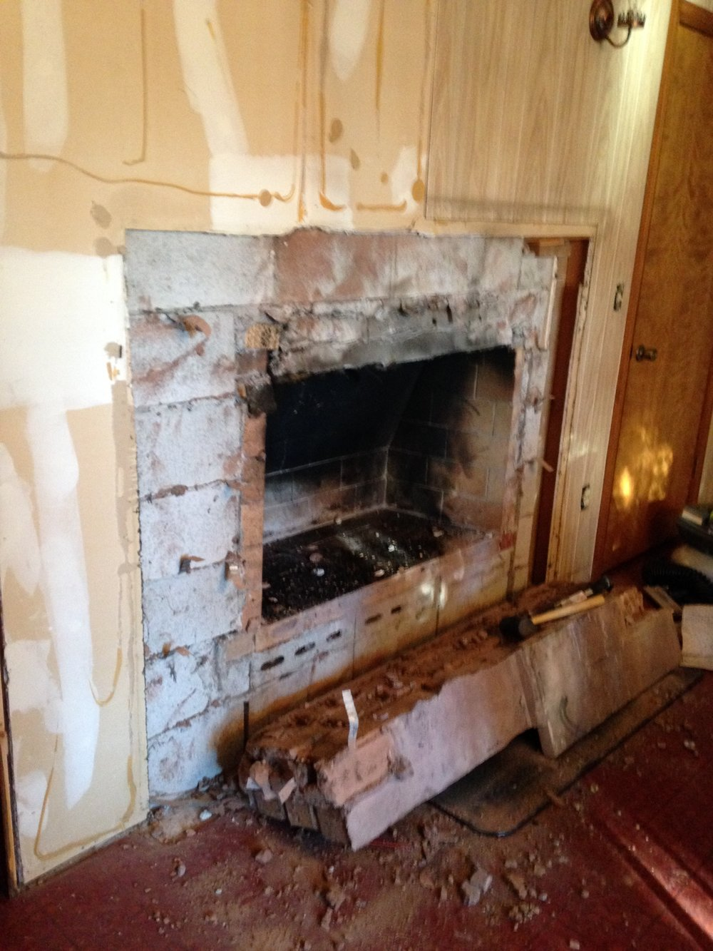 BEFORE: Dining room fireplace so old it nearly fell down looking at it.