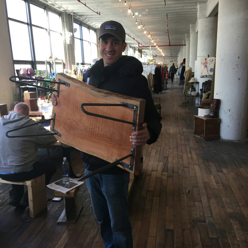 Dan with his purchase of our live edge Cherry coffee table.