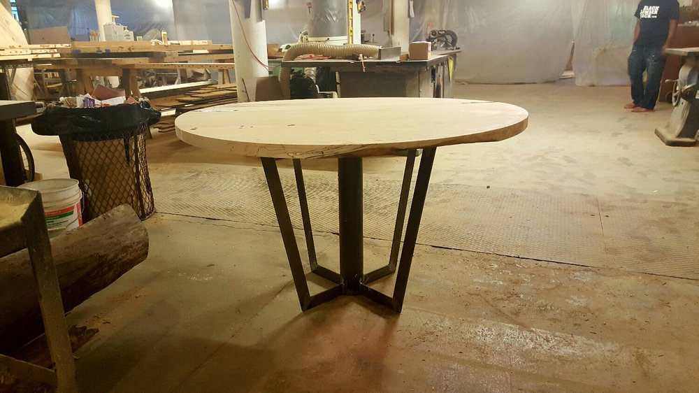 Circular table top on metal base. We're not finished yet but we like the look.