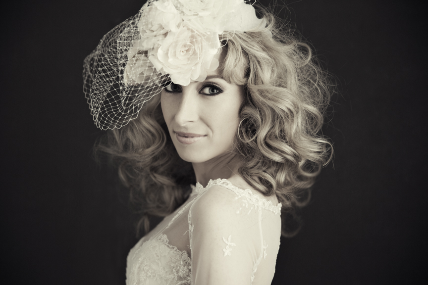 bridal hair out with birdcage veil