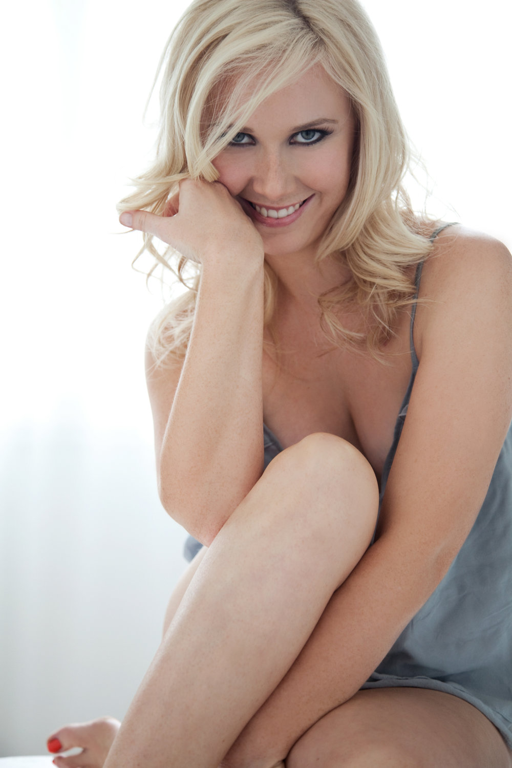 professional photo of blond woman with cheeky smile