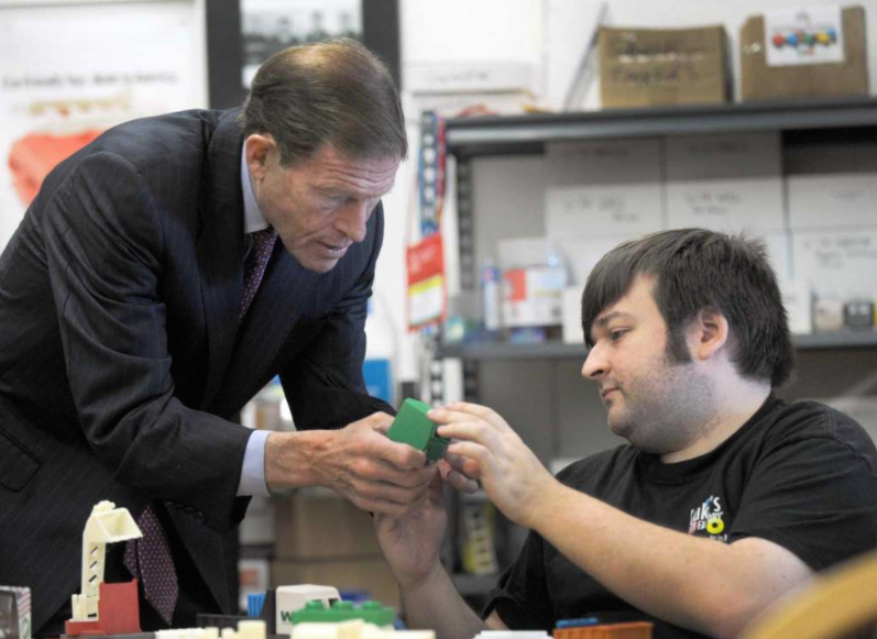 U.S. Senator Richard Blumenthal (D-Con.) inspects a Cargo Truck Cab at Luke's Toy Factory.