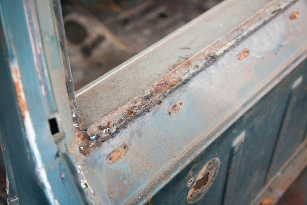 Rust in the typical areas is evident, like this back window area. Sandblasting will uncover the full extent of the damage.
