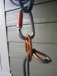 "As with the Reverso and ATC Guide, the follower's strand of rope (or the ""load"" strand"") is on top in this pic. Unlike the Reverso and ATC Guide, though, when using a rope of less than 10mm in diameter, it is not enough to simply clip the rope in the back with a block biner–as is pictured here. This photo, therefore, is of a GiGi set up INCORRECTLY when belaying a single rope of less than 10mm."