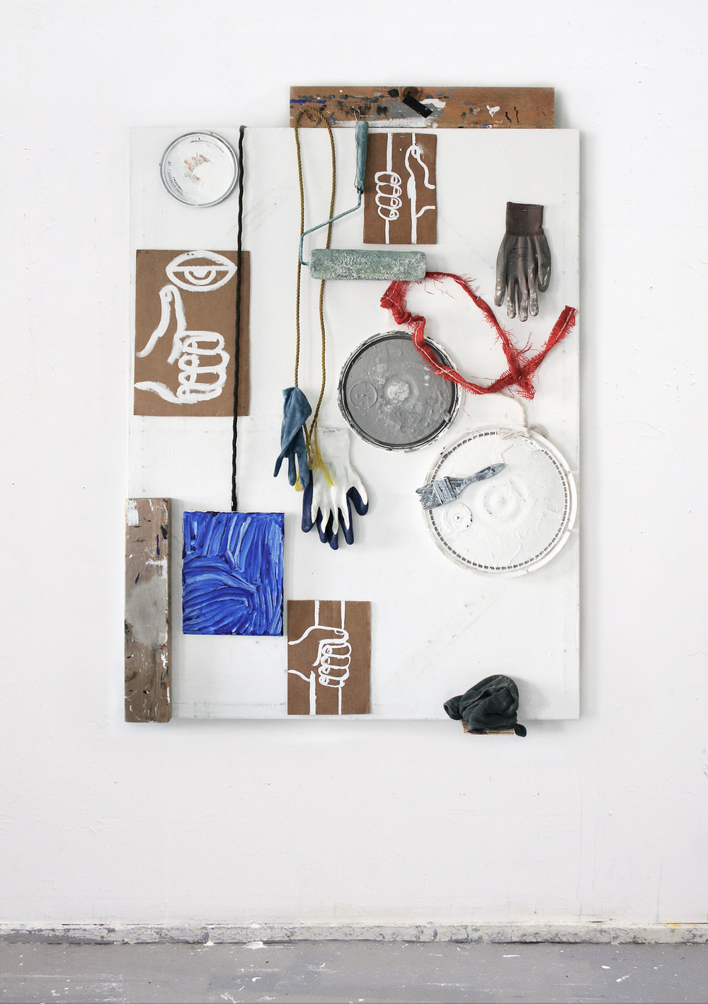 "Hand Jobs , 2016 Wood, latex, oil, cardboard, gloves, indigo dye, rope, paint can lids, brush, paint roller, rag, canvas 36"" x 52"""