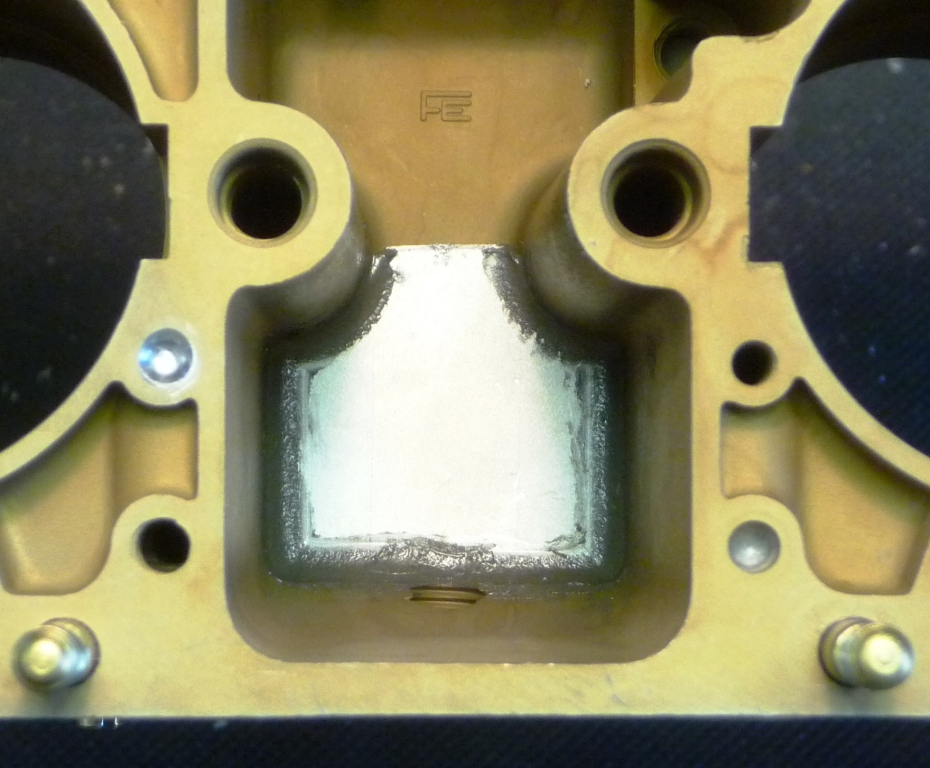 Baffle plate installed over main jet carriers after the fuel pick-up points have been milled  closer to the floor of the float bowl.  Two baffle plates are required per throttle body.