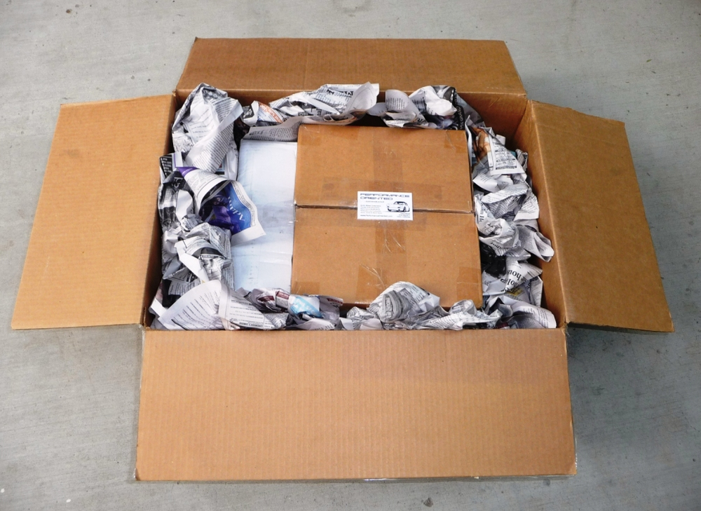 Surround shipped parts with packaging media inside an inner box and protect all six sides with packaging media inside a larger box.