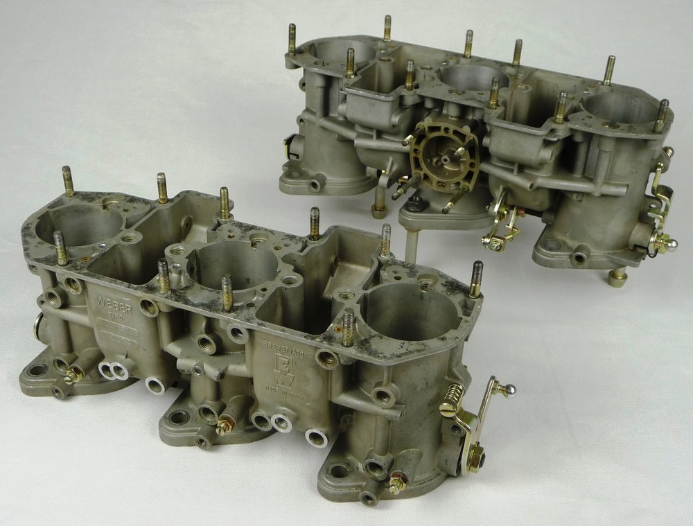 """A pair of """"Level 1: Throttle Housing Only""""after service is completed. Note what items are shown in the image to know what items to send for this service. Also note the restored finishes on the adjusting screws and levers as well as the machined bungs for the main jet holders and float bowl drain bolts."""
