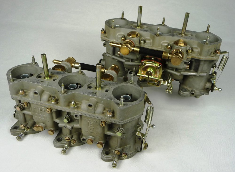 "A pair of "" Level 2: Complete Carburetor Re-Manufacturing "" after service is completed.  Only those items shown in the image are to be sent for this service.  Note the restored finishes on those items readily removable for servicing.  This set is from a 1969 911T."