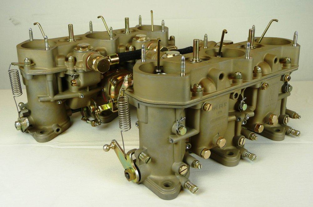 "A pair of "" Level 3: Complete Carburetor Re-Manufacturing "" after service is completed.  Only those items shown in the image are to be sent for this service.  Note the restored finishes on all items.  This set is from a 1968 911S."