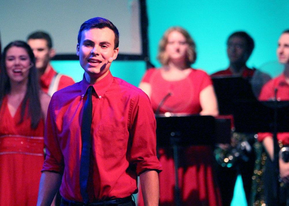 Wisconsin Singers Aaron sings.jpg