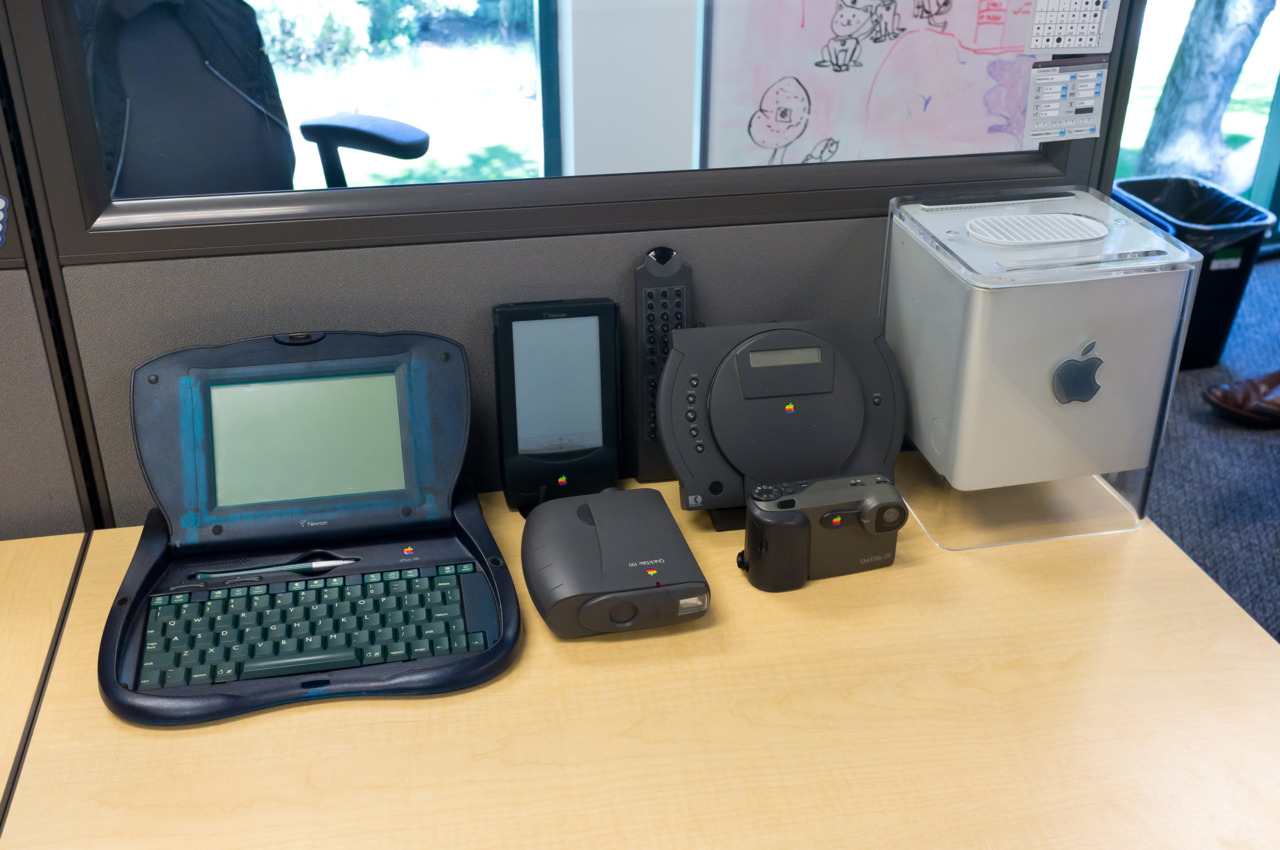 The Growing Collection eMate 300, Newton MessagePad 100, QuickTake 150 & 200, PowerCD Player, and a Cube.  What's missing? NeXTcube, 20th Anniversary Mac, Macintosh TV, and an Interactive Television.