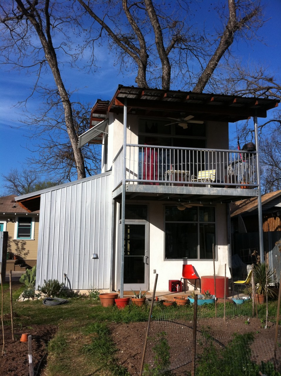 My SXSW experience included a littlemetallichouse Again, I used Airbnb. The tiny house was primarily glass, metal, concrete, and wood (like an Apple store). The room sticking out on the left is the bathroom. Behind me is the chicken coop, and in front is the garden that I was required to water.