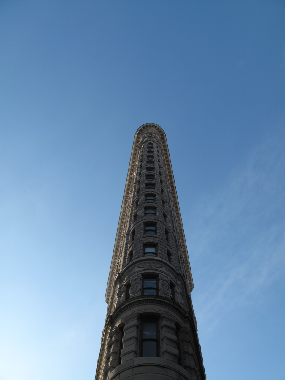 Flatiron Above Every time I visit New York City, seeing the Flatiron building is my #1 priority. I absolutely adore it. Amesmerizingbuilding with a nearby Shake Shack for burgers/shakes, and an Italian-themed Whole Foods called Eataly.