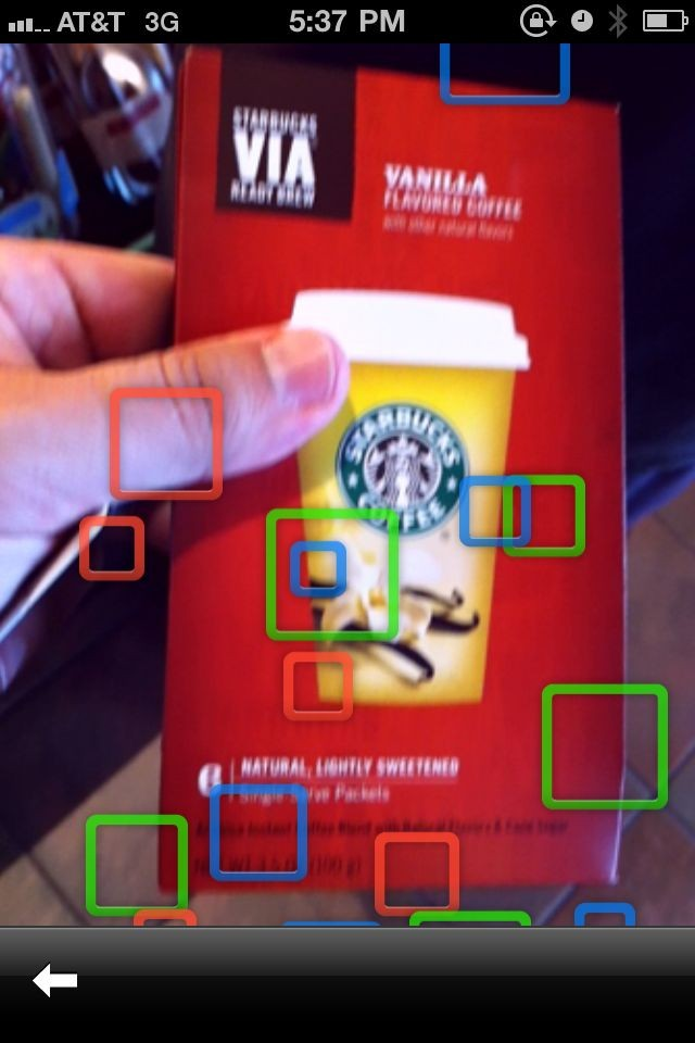 Google Goggles on the iPhone Very cool waiting animation. Blur added by the app.