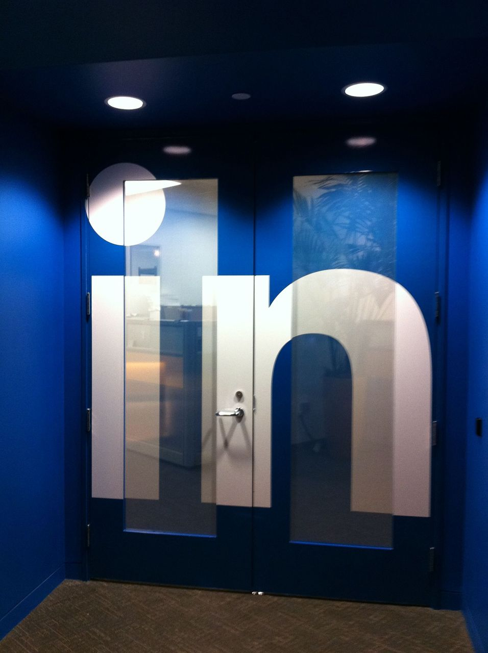 """LinkedIn HQ When I start a company I want """"DK"""" on the doors. Cornell and Dartmouth had an alumni event together at the LinkedIn HQ in Mountain View. Several recruiting experts talked about how to make an effective LinkedIn profile, along with other job seeking/recruiting tips. My favorite parts were: The host made a historical reference to Jesus Christ. A panelist said you should only have a picture in your LinkedIn profile if you are """"diverse."""" Another panelist said you shouldn't have a picture in your profile if you're """"fat and ugly."""""""