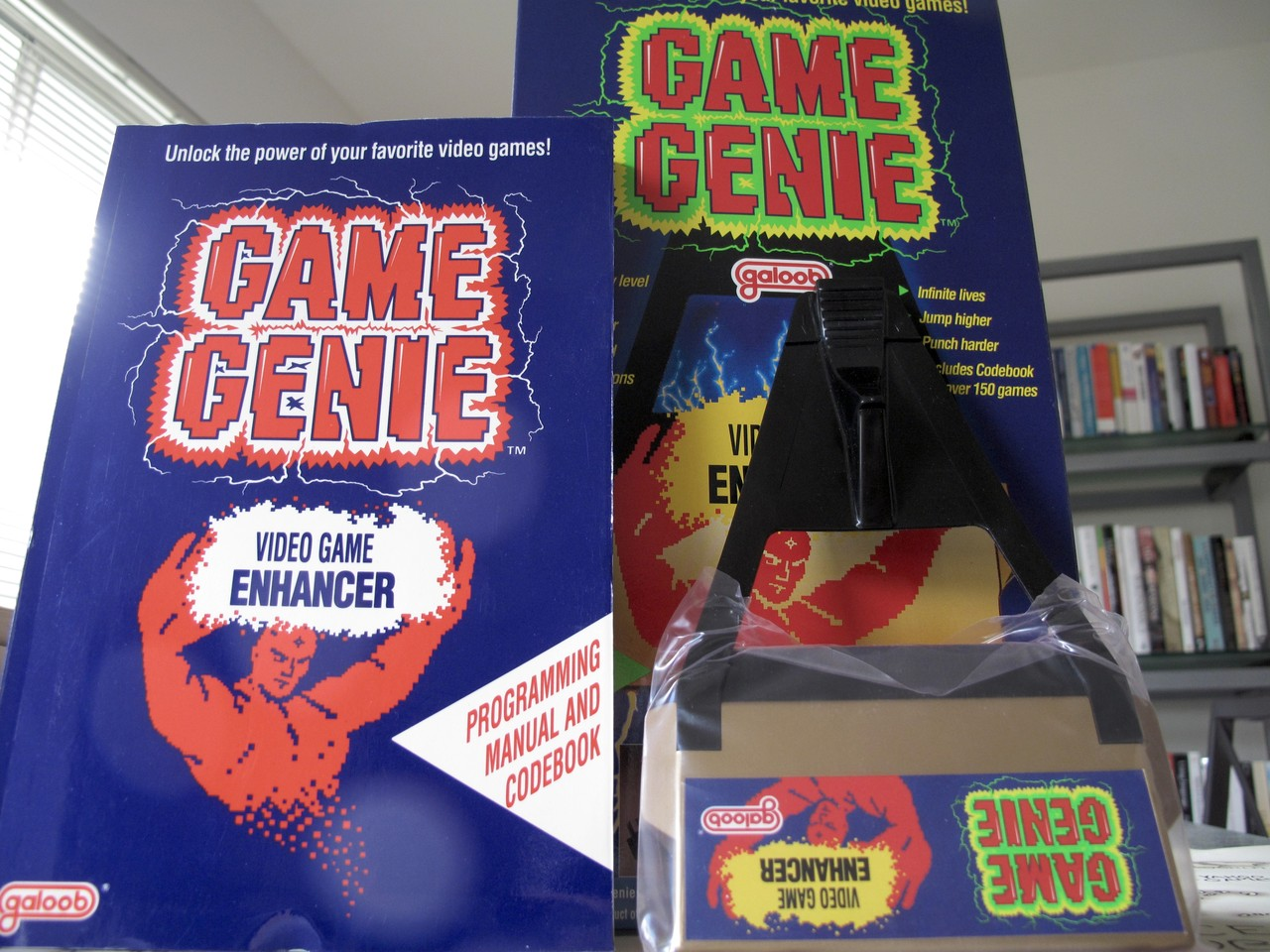 "I found a Game Genie While rummaging through old boxes last weekend, I found a perfectly intact Game Genie box with the code book and a shrink-wrapped Game Genie. Amazing. Do you remember using one? Well, if you did, you can thank my Dad for its existence. He represented Galoob in court against Nintendo (they really didn't want players to ""cheat"" on their games). Galoob won."