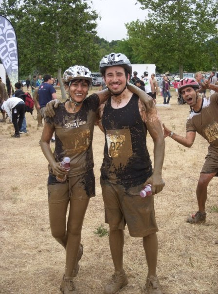 Me and Suchi after the Muddy Buddy: Suchi and I ran the Muddy Buddy race. It was awesome. I felt slightly dirty afterwards. It's a pretty tough 10k that alternates between biking, running, and obstacles. In the back is one of the founders of iControl being goofy. Go team Muffin Tops!