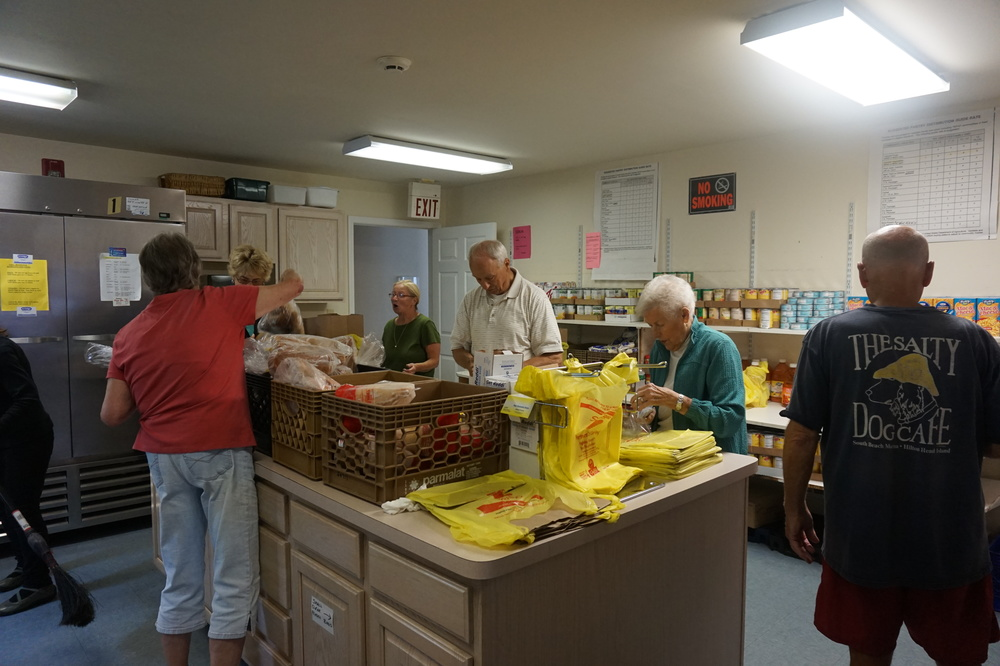 Our volunteers devote countless hours to sorting and bagging food for our clients.