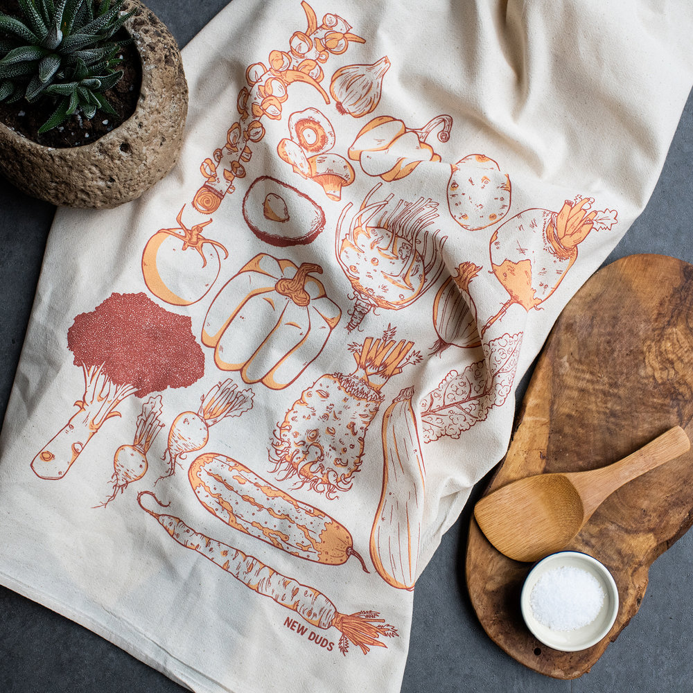 "KTVEG03: ORANGE $7  Vegetables large kitchen/tea towel  two color screenprint in orange tones on 28""x28"" towel  100% flour sack cotton - comes folded with paper wraper  USA made"