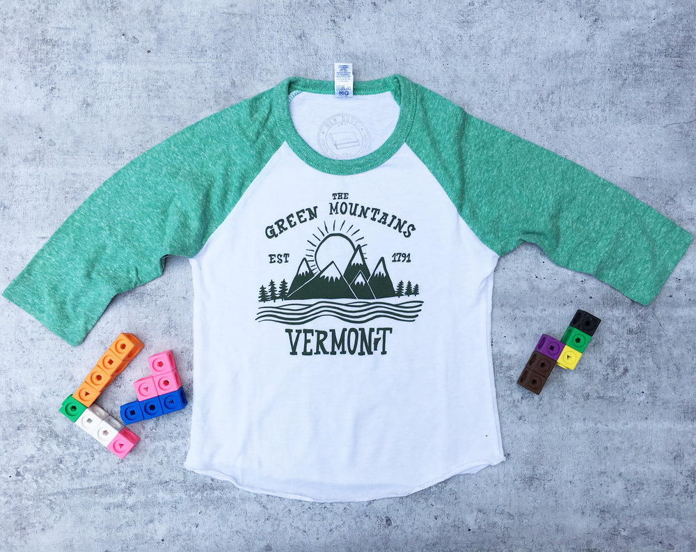 YSGRNMT01  Green Mountain Youth Baseball tee - $13  Super soft tri blend fabric in heather white and heather green  Dark green ink screenprint  Sizes: 2,4,6,8,10,12  USA MADE