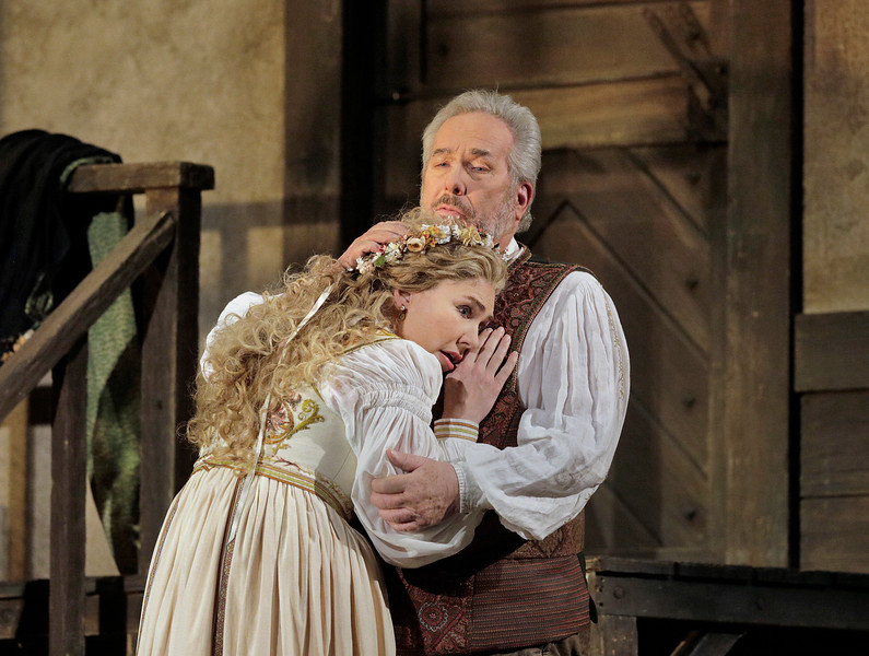 Annette Dasch as Eva is comforted by James Morris as Hans Sachs