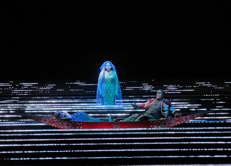 A dream image at sea at night in Robert Lepage's production of  L'Amour de Loin