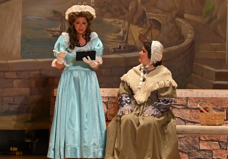 Brett Kroeger as Rose Maybud with Wendy Falconer as Dame Hannah explaining etiquette subtleties