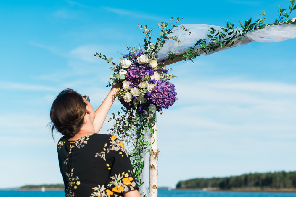 genevieve from valley coastal events assembling a custom arbour at a wedding in Gold River, Nova Scotia