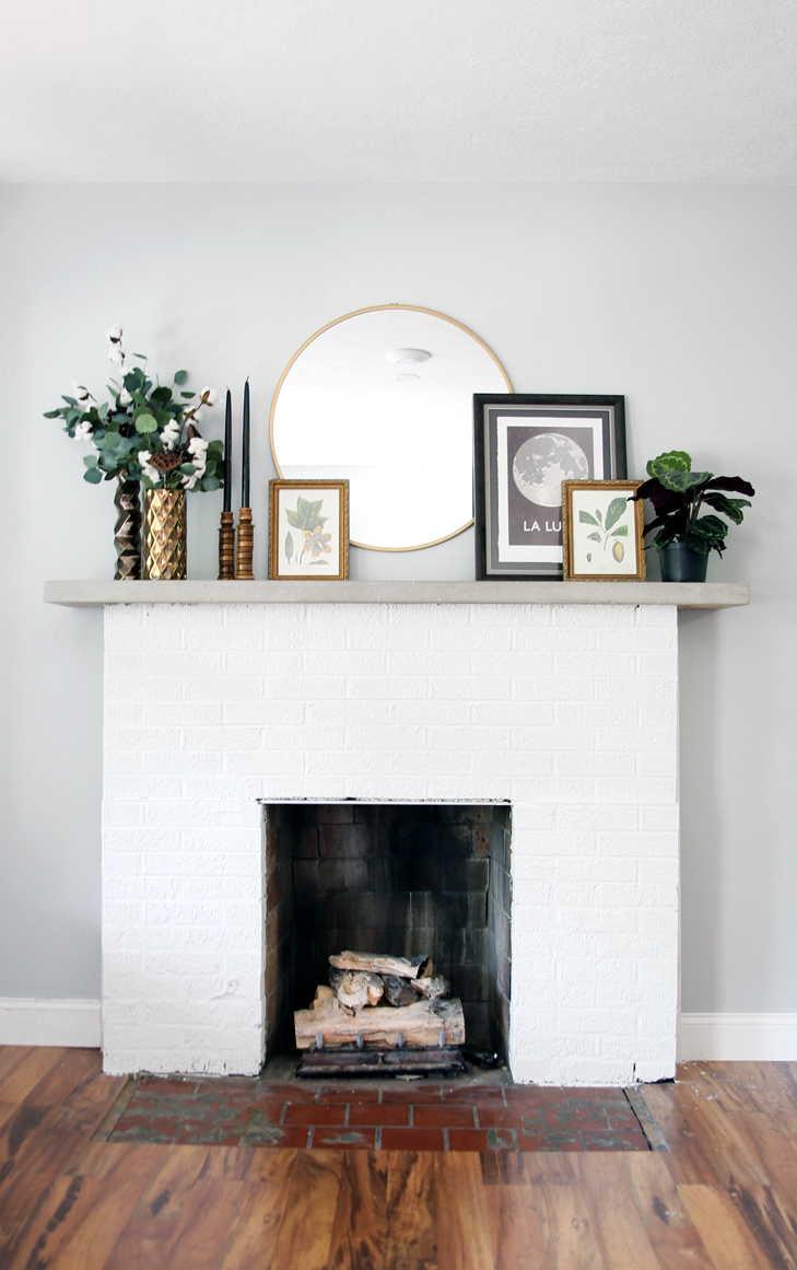 living+room+update+painting+fireplace+white.jpg