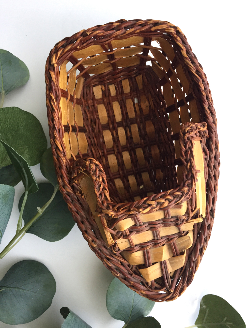 "Two toned woven boat basket would be a great addition for a boho beach house or lake cottage. Measures 8.25"" long by 3.75"" tall."