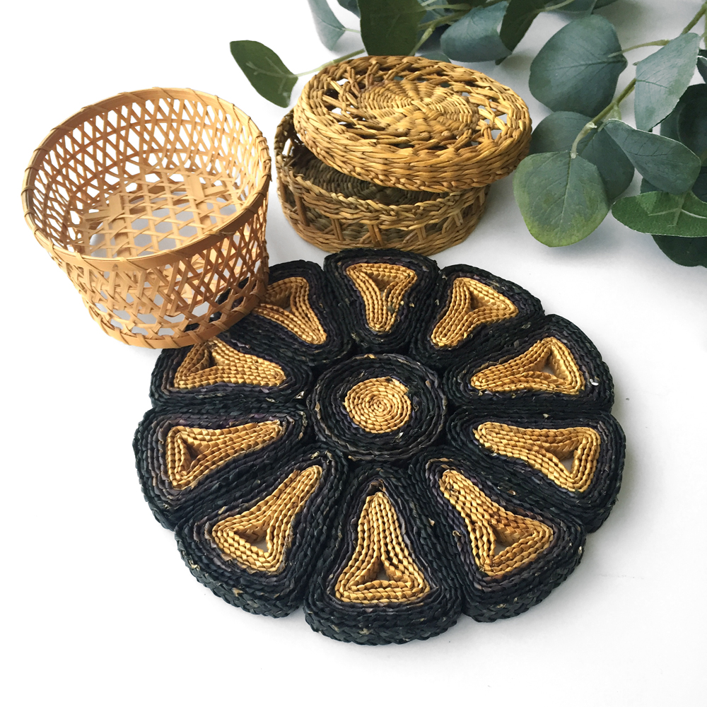 "Smaller trio to display alone or as addition to larger baskets. Black and natural trivet measures 7.25"" and 1/2"" high. Oval basket is 5.25"" high, 4"" wide and 2"" deep. Small lidded basket is 4.5"" wide and 2"" deep."