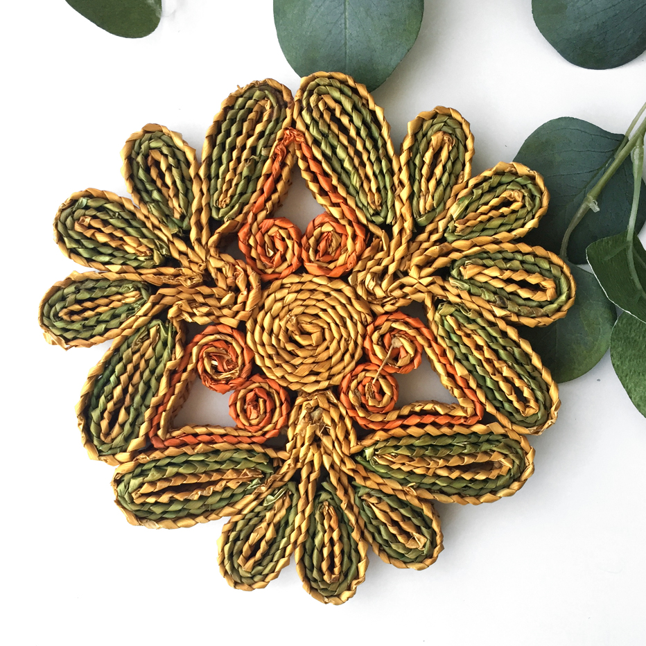 "Made of natural and dyed sage green and orange straw. Perfect to add onto an established set of wall baskets or for everyday use in the kitchen. Measures 7.5"" wide."