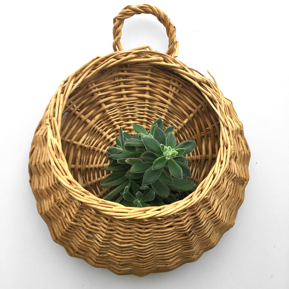 "I love these pocket baskets! I've used mine to add  a little greenery  to my own decorative basket wall and this piece would be great for yours! Opening measures 8.5"" wide and base is 13"" wide. Handle is decorative only (or could be completely removed if you want). Does not include plant."