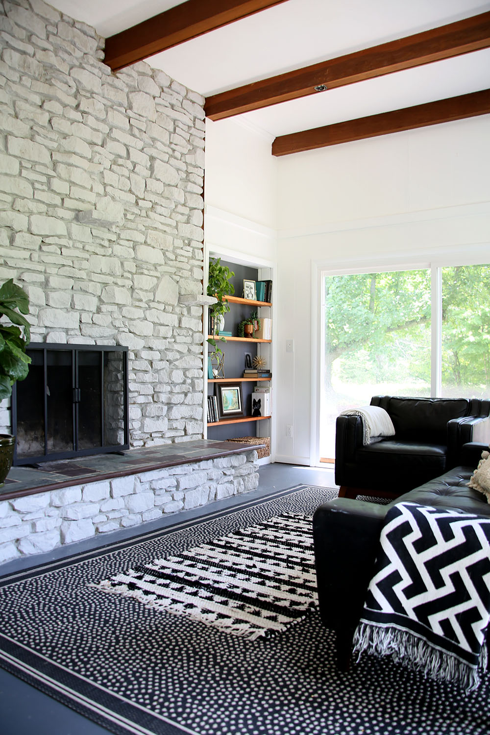 White Washed Stone Fireplace and Sunroom Makeover