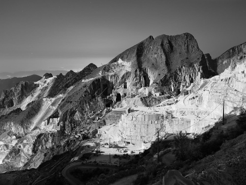 Night view of the right side of the marble basin of Fantiscritti in Carrara, with about 30 quarries and over 30.000 ton per month of extracted marble. The area of Carrara is indeed the most productive in the world with 1 billion of tons of white marble per year.