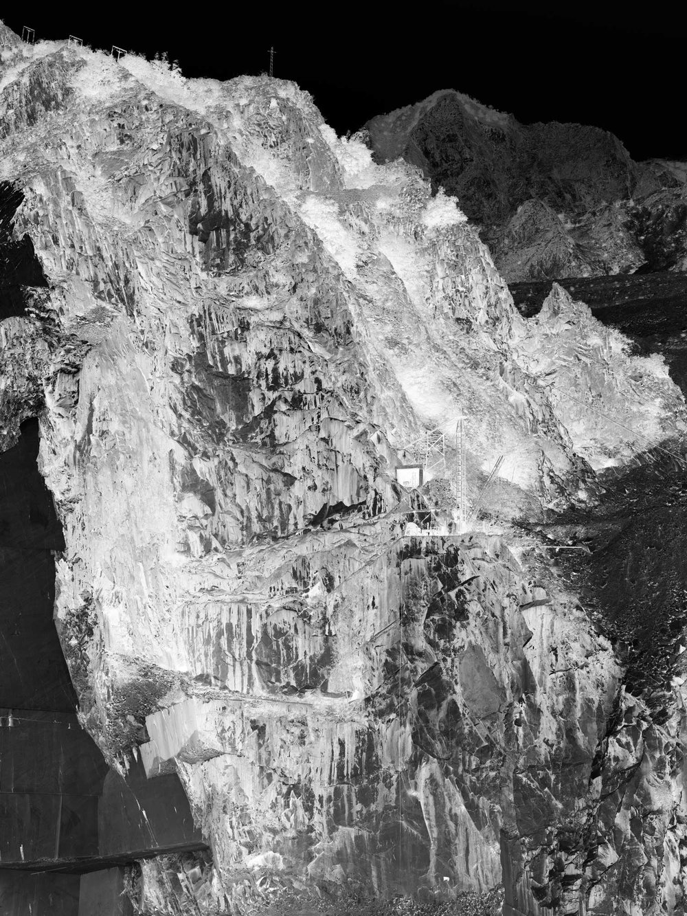 a negative photo of one of the giant walls of marble in the Torano basin, few kilometers North-West of Carrara, with more than 30 active quarries, worlwide famous for statuary white marble.