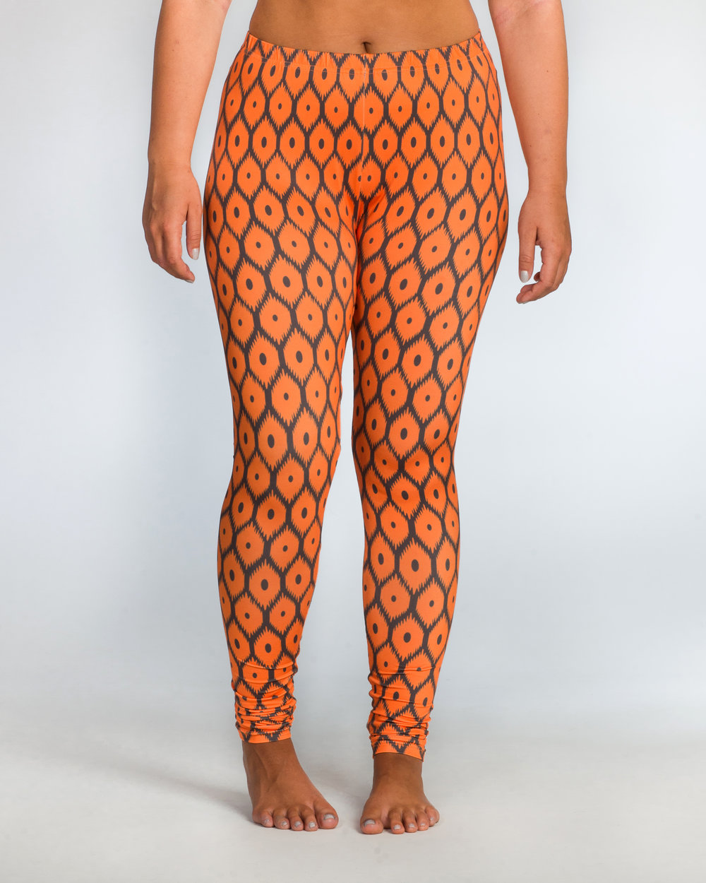 """Scout is 5' 8"""" tall, has 33"""" hips, and chose a size XL in our Tennessee Flamestitch Leggings."""