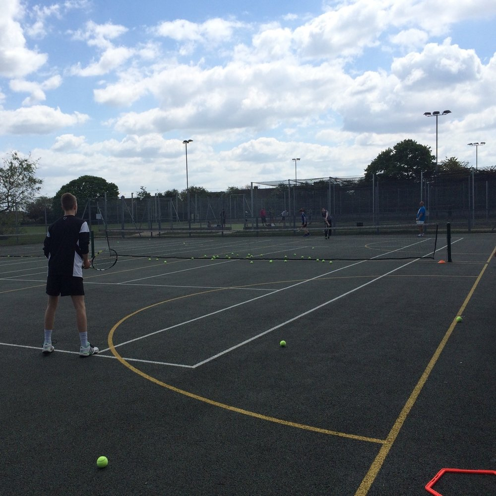 Tennis For Teens - Competitive and challenging group lessons for children 12 to 16 years old.
