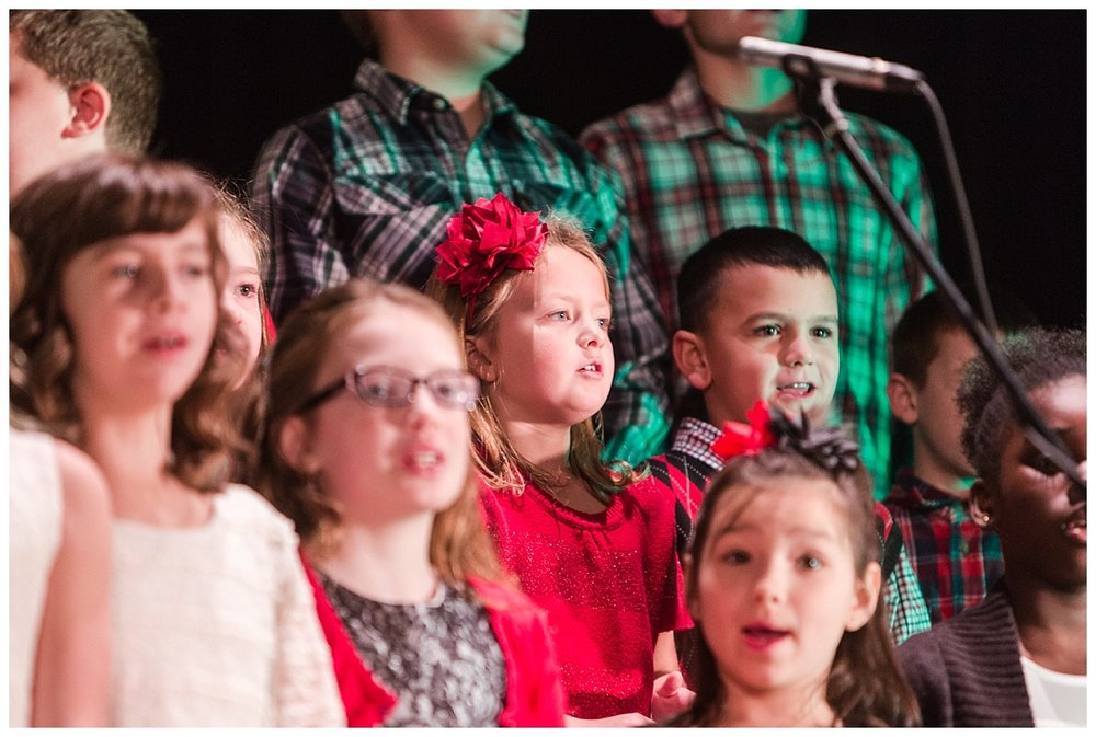 Macy singing in the kids choir for the service.