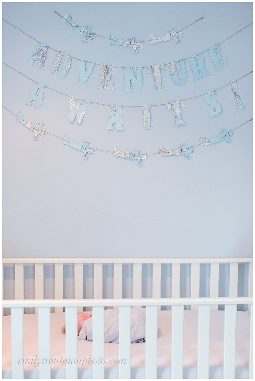 A sweet blue nursery full of adventure details for a little prince!