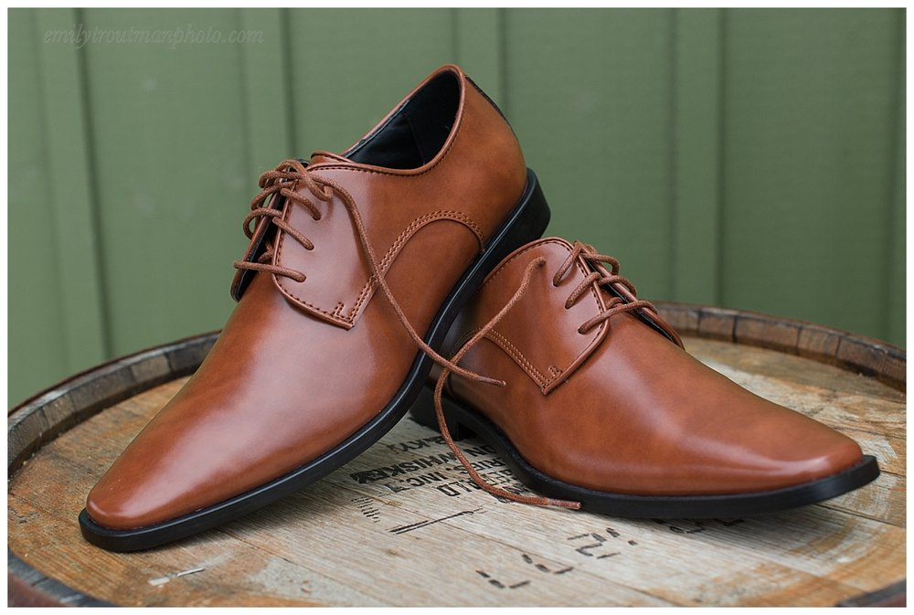 Sleeks groom's shoes on a whiskey barrel