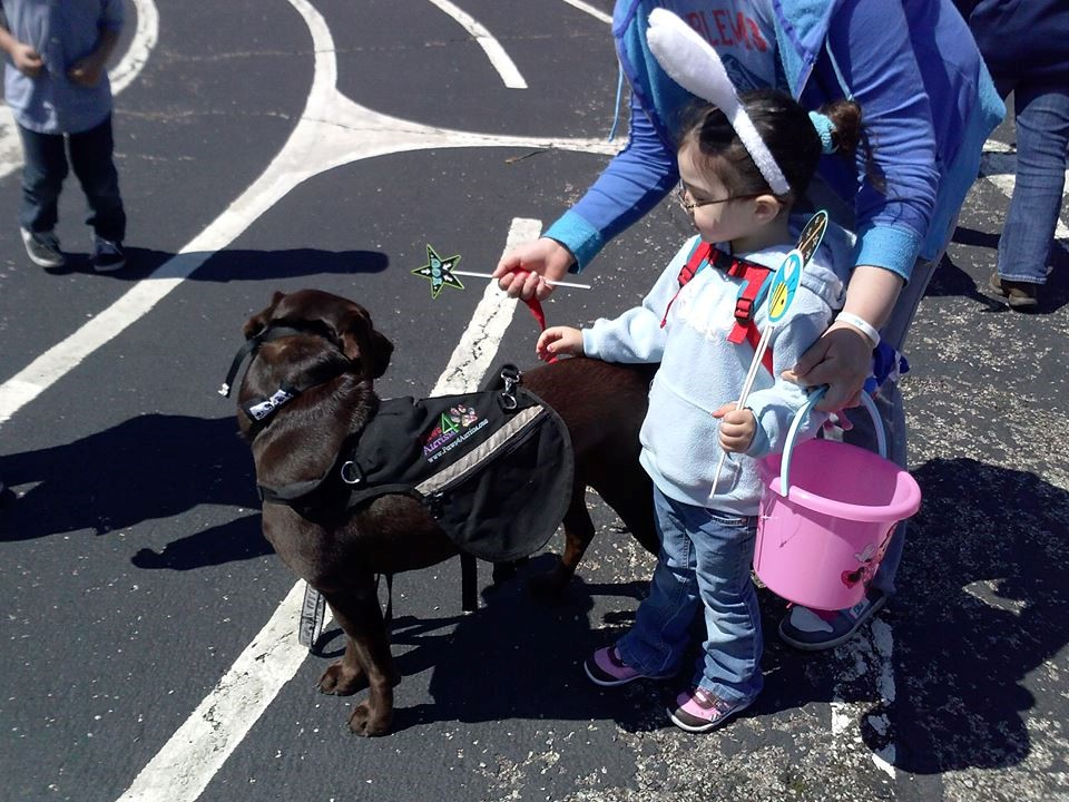 Sophia with Grady at the 2014 Autism Egg Hunt