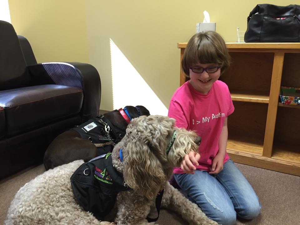 Maddie calming down with Franklyn at an event.