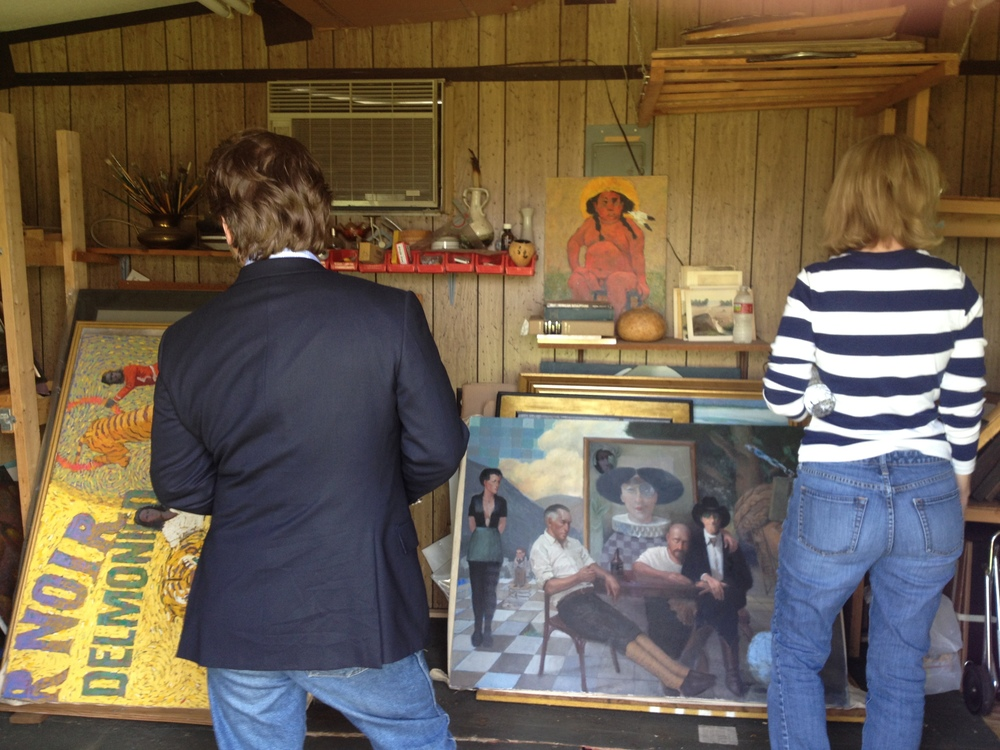 Ghislain d'Humieres, former director of the Fred Jones Museum, with Julie, looking at the paintings in the shed.