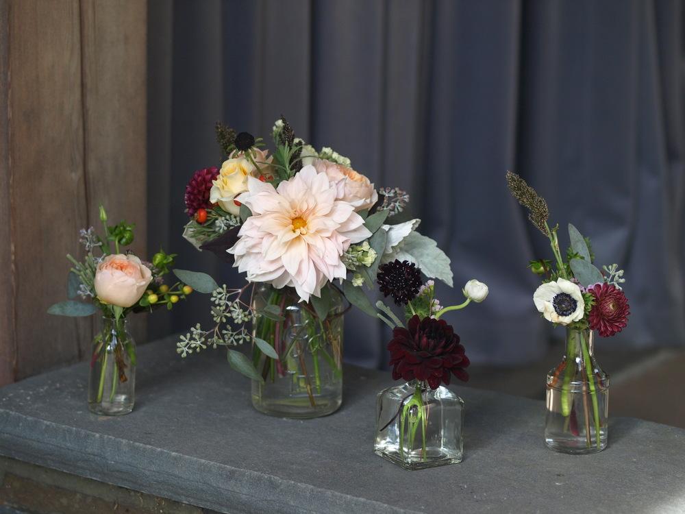 Oreonta house woodstock wedding bud vase with orange ranunculous, lambs ears, grey brunia, red berries and red rosehips and wildflowers rosehip social rosehip floral and bud vases.JPG