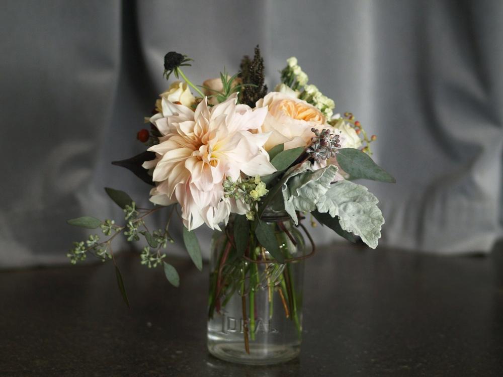 Oreonta house woodstock wedding vintage mason ball jar centerpiece with garden rose dahlia dusty miller scabiosa grey greens and wildflowers rosehip social rosehip floral.jpg